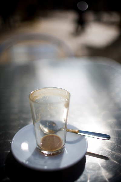 Empty coffee glass on an outdoor table, Seville, Spain