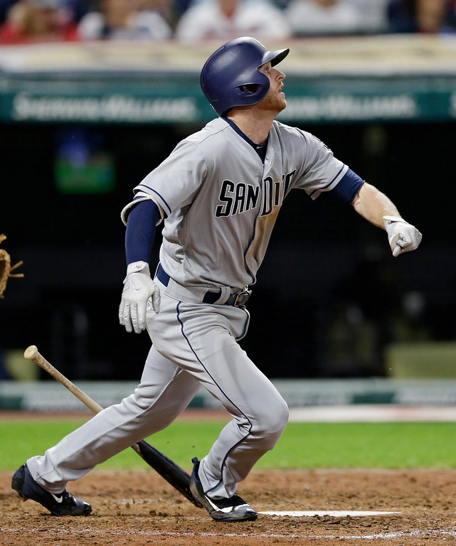 . San Diego Padres\' Cory Spangenberg watches his ball after hitting a two-run home run off Cleveland Indians relief pitcher Zach McAllister in the seventh inning of a baseball game, Wednesday, July 5, 2017, in Cleveland. Wil Myers scored on the play. (AP Photo/Tony Dejak)