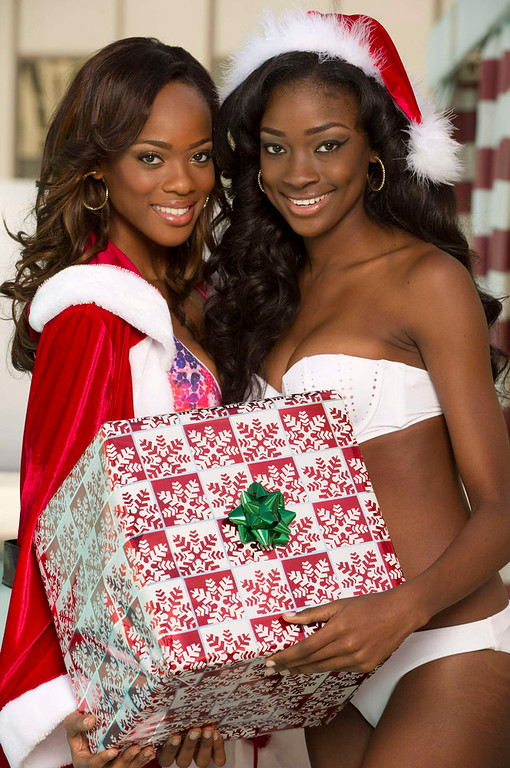 . Avionne Mark of Trinidad & Tobago and Celeste Marshall of Bahamas pose for photographs as part of preparations for the Miss Universe 2012 pageant in Las Vegas, Nevada December 4, 2012. The pageant, will be held on December 19, 2012 at the Planet Hollywood Resort & Casino in Las Vegas. REUTERS/Valerie Macon/Handout