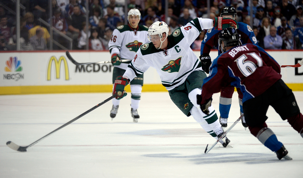 . Mikko Koivu (9) of the Minnesota Wild skates the puck past Andre Benoit (61) of the Colorado Avalanche during the second period of action. The Colorado Avalanche hosted the Minnesota Wild for the first playoff game at the Pepsi Center on Thursday, April 17, 2014. (Photo by John Leyba/The Denver Post)