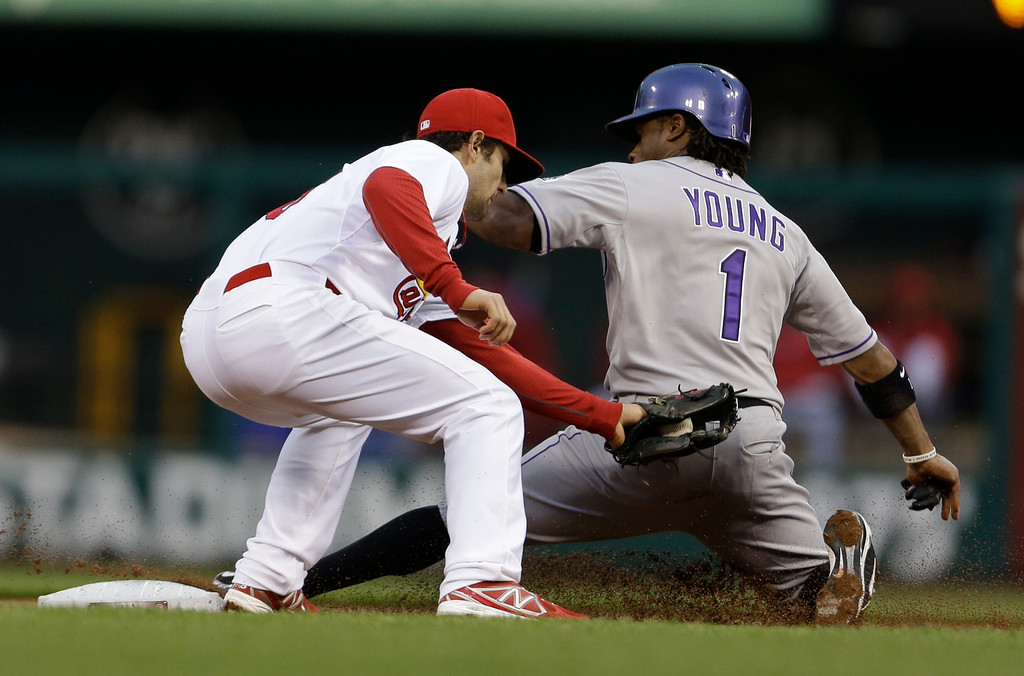 . Colorado Rockies\' Eric Young Jr., right, is safe at second ahead of the tag from St. Louis Cardinals shortstop Pete Kozma for a stolen base during the first inning of a baseball game Friday, May 10, 2013, in St. Louis. (AP Photo/Jeff Roberson)