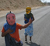 Kids set-up road blocks in order to solicit donations for New Year's eve, an Ecuadorian tradition