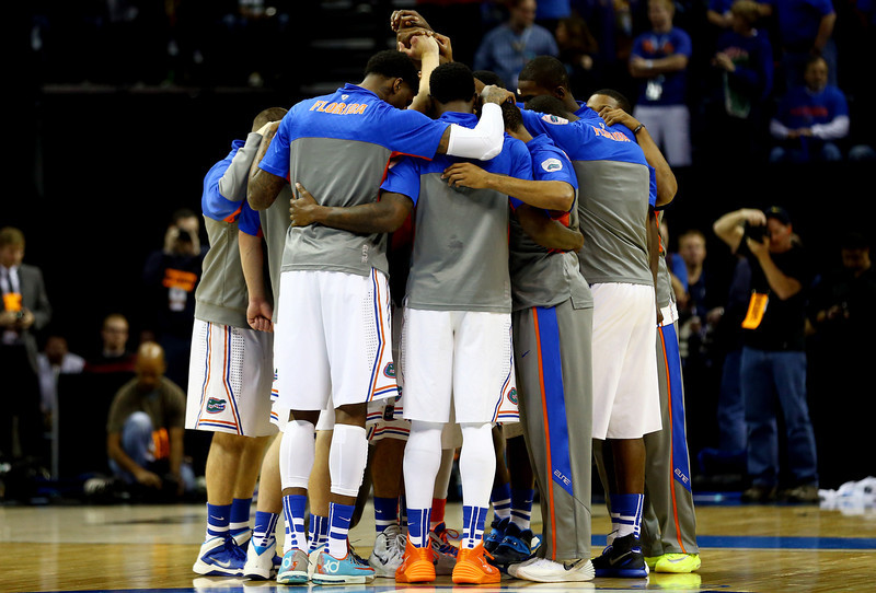 . The Florida Gators huddle prior to the south regional final of the 2014 NCAA Men\'s Basketball Tournament against the Dayton Flyers at the FedExForum on March 29, 2014 in Memphis, Tennessee.  (Photo by Streeter Lecka/Getty Images)