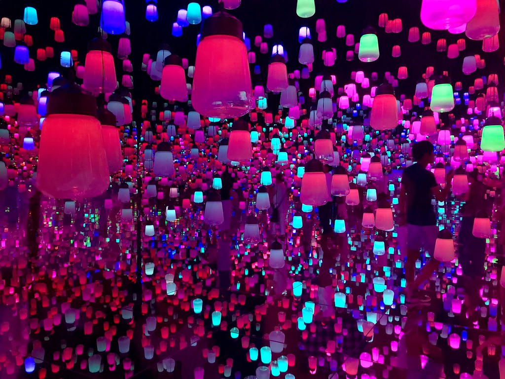 A thousand lamps suspended in a mirrored room.