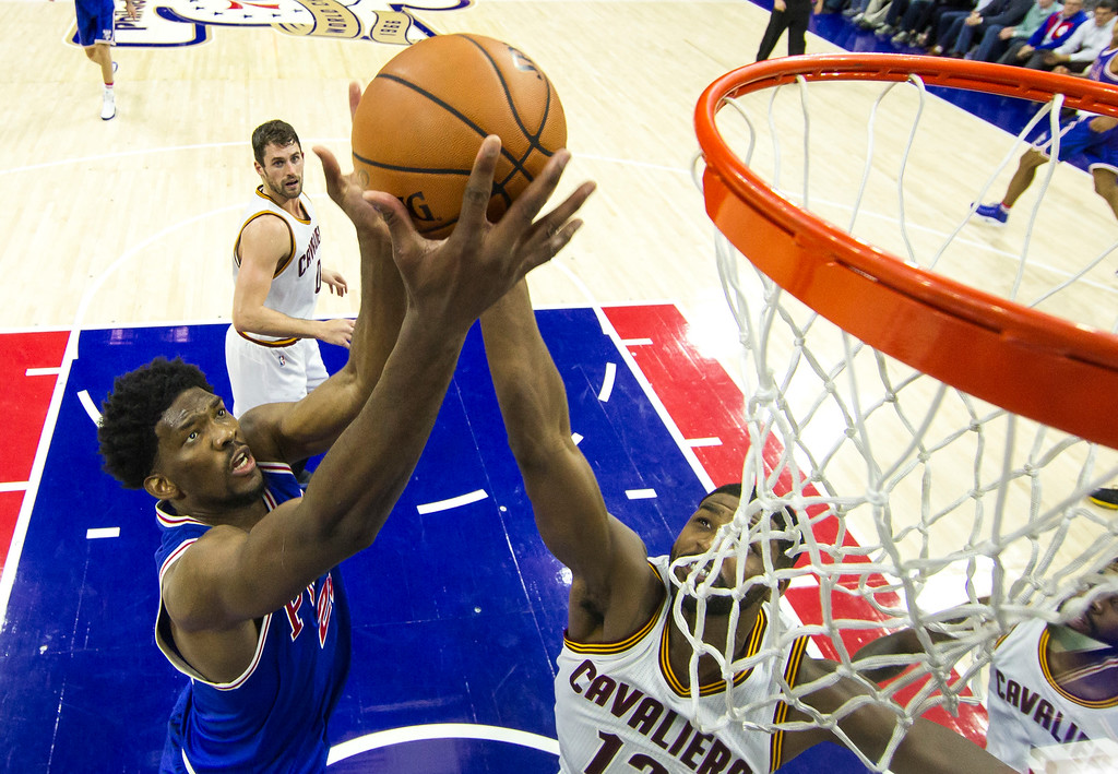 . Philadelphia 76ers\' Joel Embiid, left, and Cleveland Cavaliers\' Tristan Thompson go up for a rebound during the second half of an NBA basketball game, Saturday, Nov. 5, 2016, in Philadelphia. The Cavaliers won 102-101. (AP Photo/Chris Szagola)