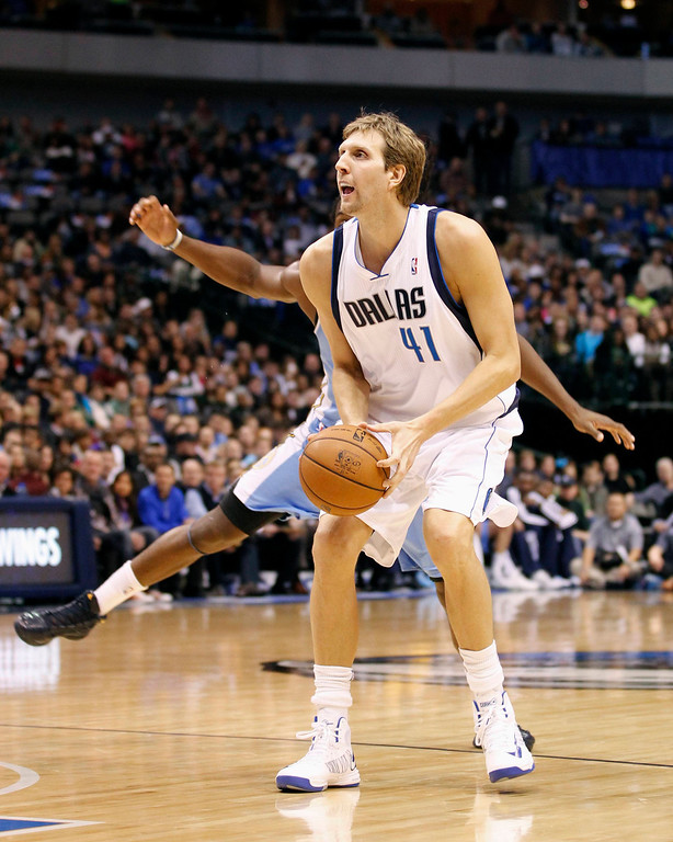 . Dallas Mavericks forward Dirk Nowitzki prepares to shoot against the Denver Nuggets during the first half of their NBA basketball game in Dallas, Texas December 28, 2012. REUTERS/Mike Stone