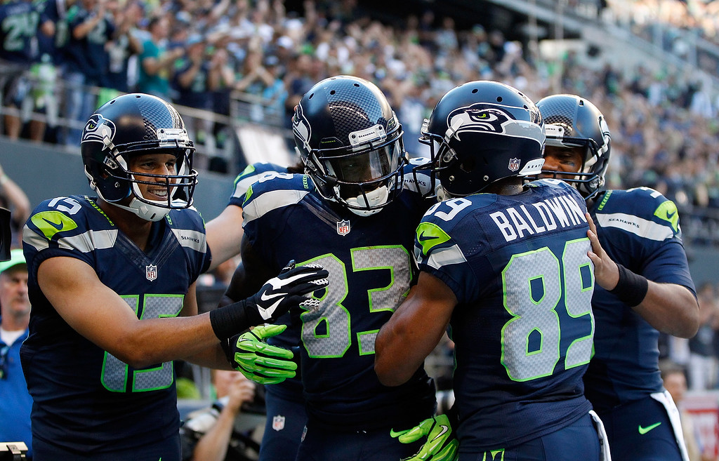 . SEATTLE, WA - SEPTEMBER 04: Wide Receiver Ricardo Lockette #83  of the Seattle Seahawks celebrates with teammates after scoring a touchdown during the second quarter of the game against the Green Bay Packers at CenturyLink Field on September 4, 2014 in Seattle, Washington.  (Photo by Otto Greule Jr/Getty Images)