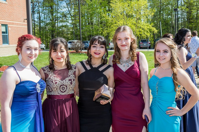 Adria Bennett, Haley Munguia, Casey Munguia, Destiny McKay and Karissa Martin, left to right, attend the Epping High School Prom Friday in Epping. [Scott Patterson/Seacoastonline]