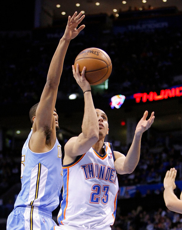 . Oklahoma City Thunder guard Kevin Martin, right, shoots against Denver Nuggets Anthony Randolph during the fourth quarter of an NBA basketball game in Oklahoma City, Wednesday, Jan. 16, 2013. Oklahoma City won 117-97. (AP Photo/Alonzo Adams)