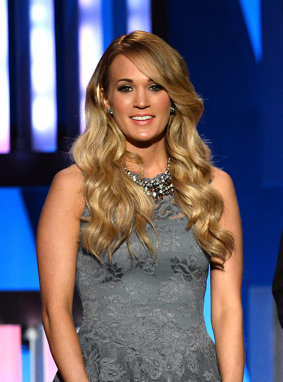 . Singer Carrie Underwood speaks onstage during ACM Presents: An All-Star Salute To The Troops at the MGM Grand Garden Arena on April 7, 2014 in Las Vegas, Nevada.  (Photo by Ethan Miller/Getty Images for ACM)