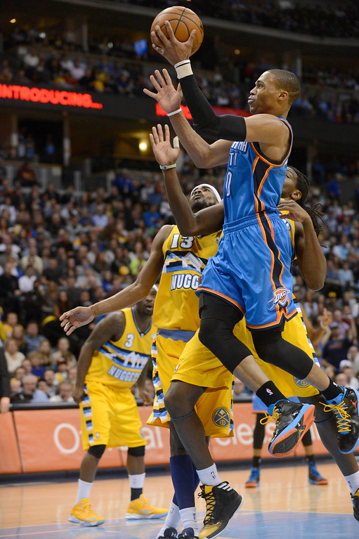 . DENVER, CO. - JANUARY 20: Oklahoma City Thunder point guard Russell Westbrook (0) drives to the basket on Denver Nuggets small forward Corey Brewer (13) during the fourth quarter January 20,  2013 at Pepsi Center. Denver Nuggets defeated the Oklahoma City Thunder 121-118.  (Photo By John Leyba / The Denver Post)