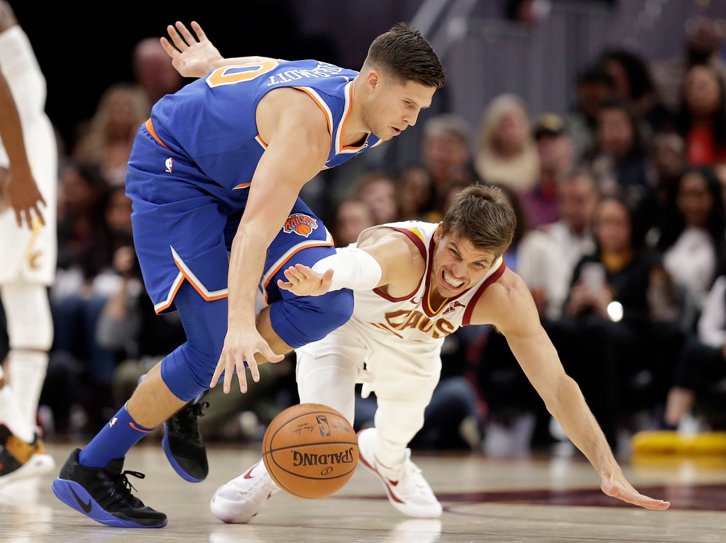 . Cleveland Cavaliers\' Kyle Korver, right, fouls New York Knicks\' Doug McDermott in the first half of an NBA basketball game, Sunday, Oct. 29, 2017, in Cleveland. (AP Photo/Tony Dejak)