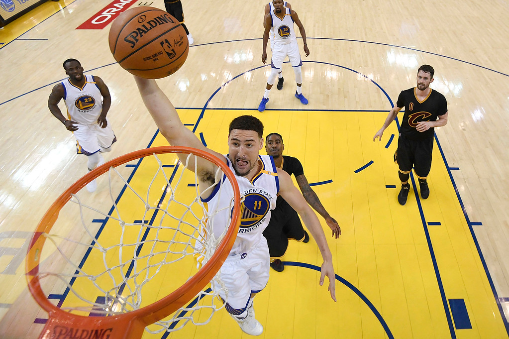 . Golden State Warriors guard Klay Thompson (11) shoots against the Cleveland Cavaliers during the first half of Game 2 of basketball\'s NBA Finals in Oakland, Calif., Sunday, June 4, 2017. (Kyle Terada/Pool Photo via AP)