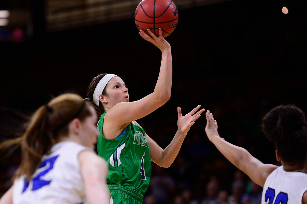 . Taylor Rusk (4) of ThunderRidge throws up an shot over the defense of Highlands Ranch during the first quarter at the Coors Events Center on March 12, 2016 in Boulder, Colorado. (Photo by Brent Lewis/The Denver Post)