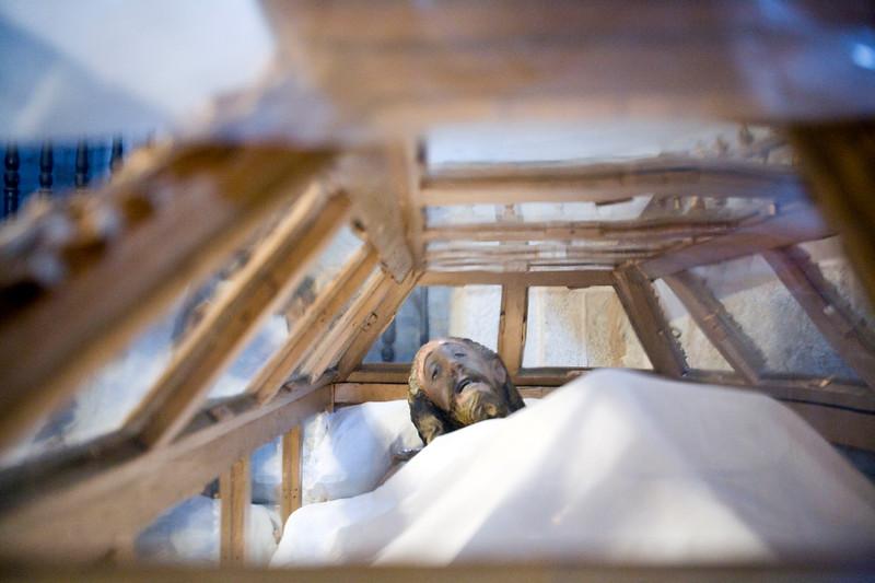Dead Jesus Christ statue inside a glass coffin, Brozas, Caceres, Spain