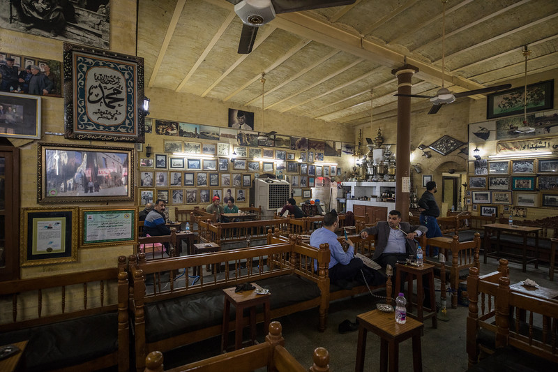 Shabandar Café, one of the most famous cafes in Baghdad. The café was founded in 1917 in the building of a former printing press. The current owner of the café shop since 1963 is Haj Mohammed Al-Khashali and there were numerous photo's of him on the wall from over the years.