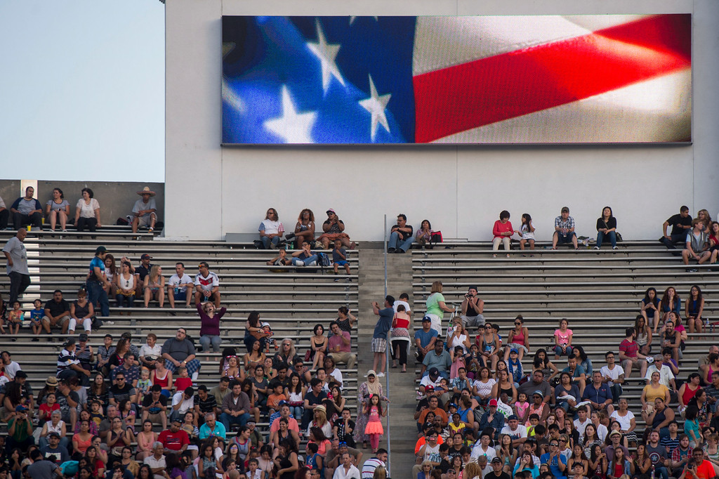 . A crowd watches teen idol Ian Thomas perform during the 88th Annual Fourth of July Celebration, Americafest at the Rose Bowl in Pasadena Friday night, July 4, 2014. (Photo by Sarah Reingewirtz/Pasadena Star-News)
