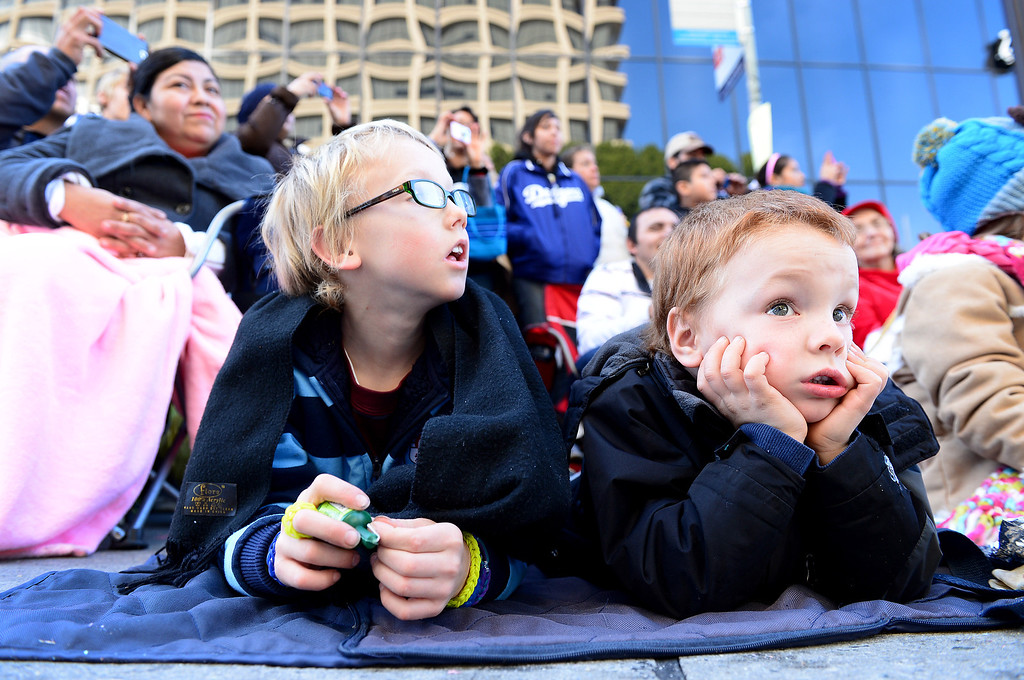 . Luke Danneker, 9, of Northridge, and his brother Cole, 4, watch the 125th Rose Parade as it heads down Colorado Boulevard in Pasadena, CA January 1, 2014. (Photo by Sarah Reingewirtz/Pasadena Star-News)