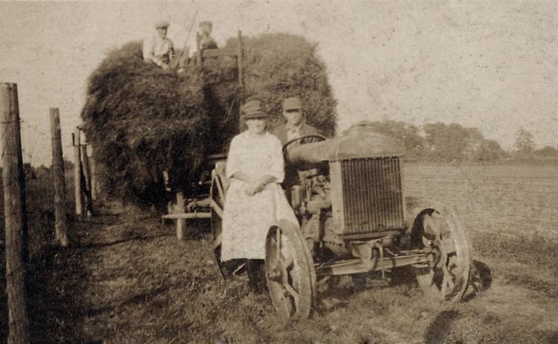 Grandpa & Grandma,Norm & Fritz Getting Hay.JPG