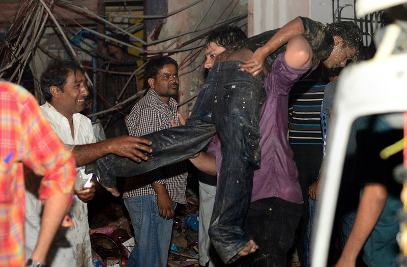 . A Pakistani rescuer carries an injured man at the site of the bomb blast in Karachi on March 3, 2013.  A bomb attack in Pakistan\'s largest city Karachi on Sunday killed at least 23 people, including women and children, and wounded 50 others, police said.  RIZWAN TABASSUM/AFP/Getty Images