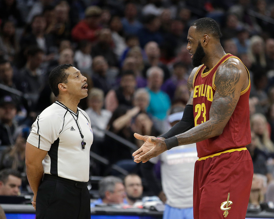 . Cleveland Cavaliers forward LeBron James, right, talks with referee Bill Kennedy after Kennedy called him for a technical foul during the first quarter of the Cavaliers\' NBA basketball game against the Sacramento Kings, Friday, Jan. 13, 2017, in Sacramento, Calif. (AP Photo/Rich Pedroncelli)