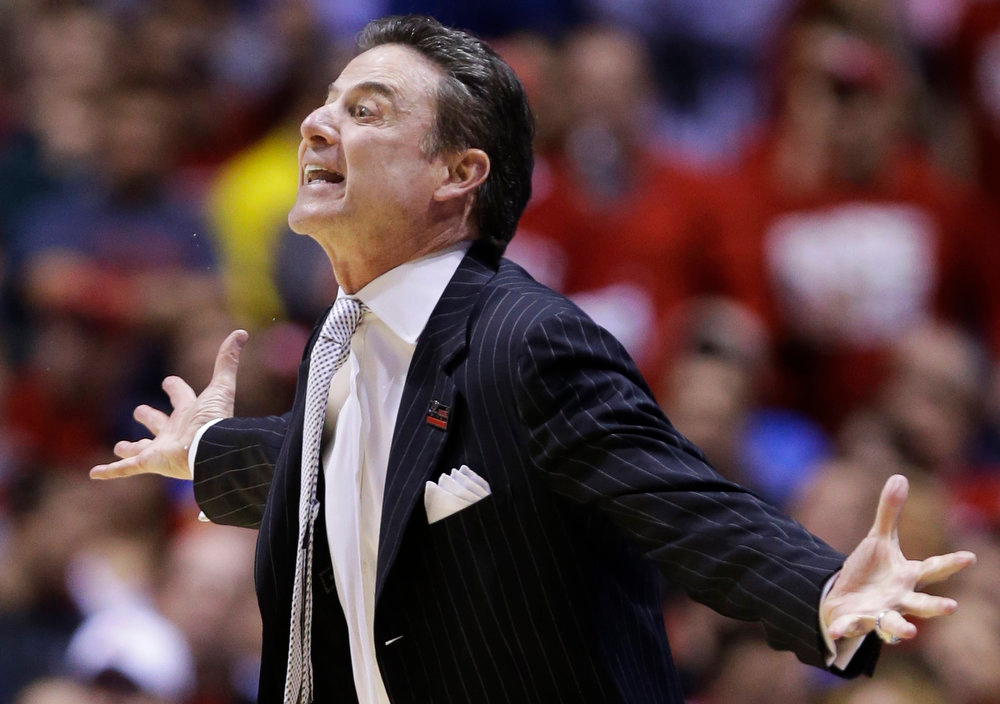 Description of . Louisville head coach Rick Pitino reacts to a call during the first half of the Midwest Regional final iagainst Duke n the NCAA college basketball tournament, Sunday, March 31, 2013, in Indianapolis. (AP Photo/Michael Conroy)