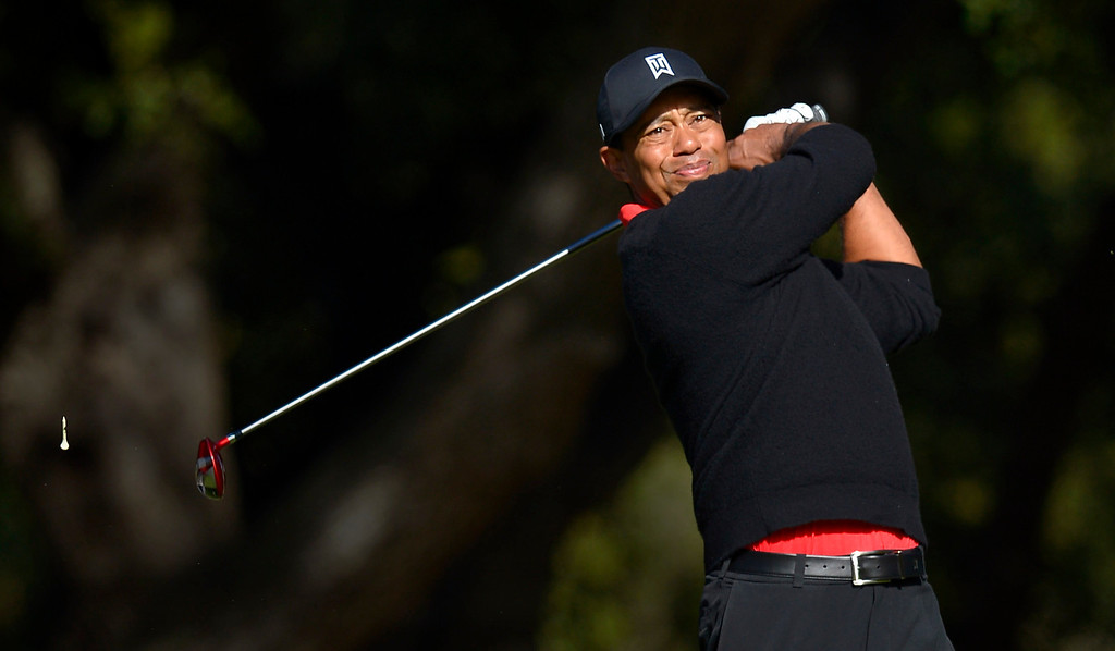 . Tiger Woods hits a tee shot on the sixth hole during the final round of the Northwestern Mutual World Challenge golf tournament at Sherwood Country Club, Sunday December 8, 2013, in Thousand Oaks, Calif.(Andy Holzman/Los Angeles Daily News)