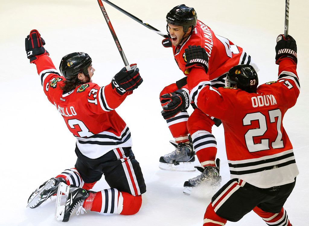 . Chicago Blackhawks\' Daniel Carcillo (L) celebrates scoring the game winning goal against the Colorado Avalanche with his teammates Niklas Hjalmarsson (C) and Johnny Oduya during the third period of their NHL hockey game in Chicago, Illinois, March 6, 2013.  REUTERS/Jim Young