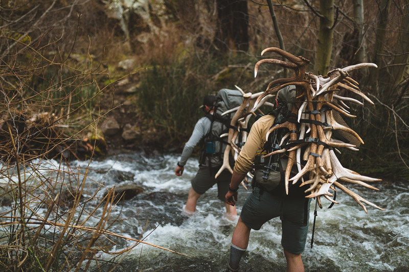 Sam Averett (samaverett) and Casey Barton (_caseybarton_) crossing a creek while shed hunting in Oregon.