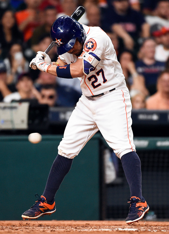 . Houston Astros\' Jose Altuve (27) jumps back from a pitch from Cleveland Indians relief pitcher Joba Chamberlain in the sixth inning of a baseball game, Monday, May 9, 2016, in Houston. (AP Photo/Eric Christian Smith)