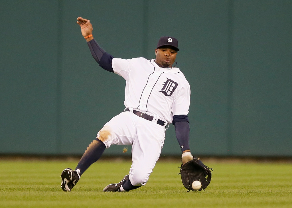 . Detroit Tigers center fielder Rajai Davis dives but misplays the single by Seattle Mariners\' Robinson Cano during the fifth inning of a baseball game, Friday, Aug. 15, 2014 in Detroit. (AP Photo/Carlos Osorio)