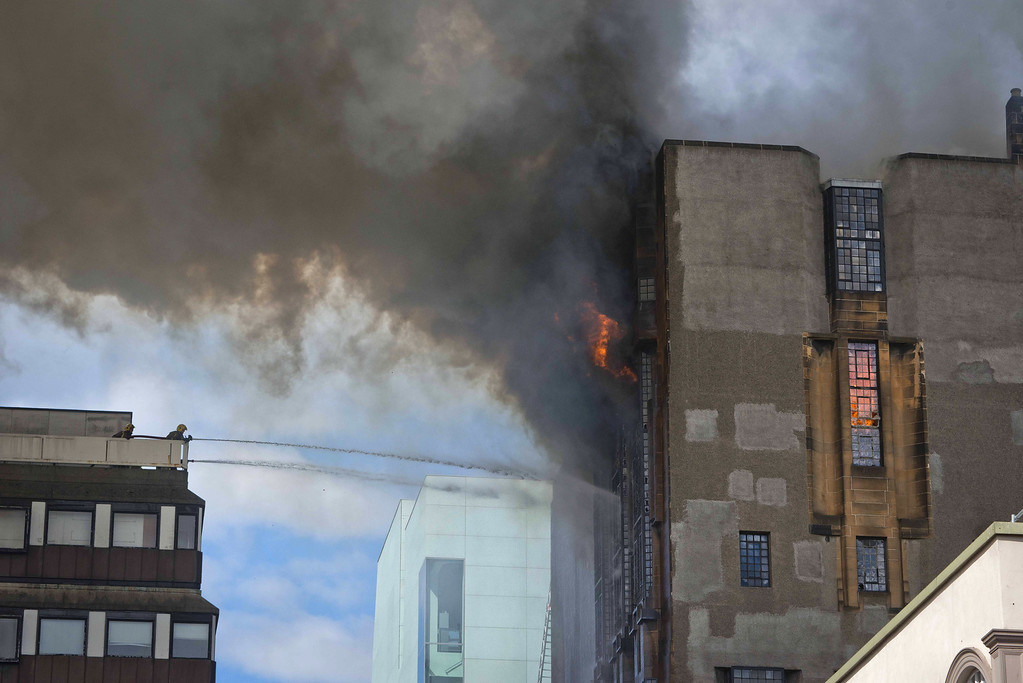 . A firefighter tackles a blaze at the Glasgow School of Art Charles Rennie Mackintosh Building on May 23, 2014 in Glasgow, Scotland.  (Photo by Chris Watt/Getty Images)