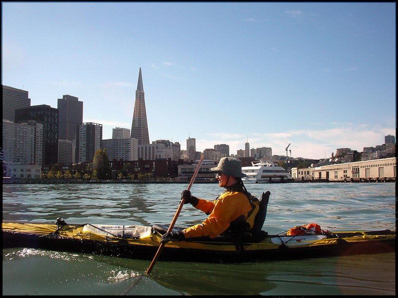 Grant in front of a classic SF skyline.