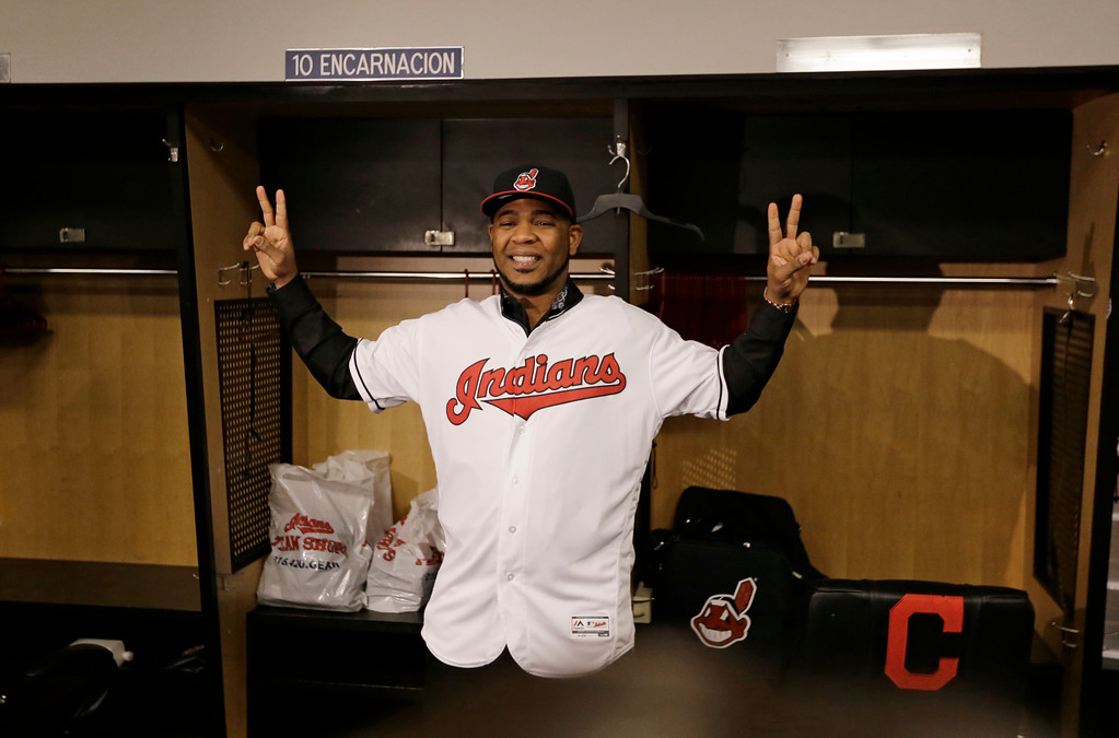 . Cleveland Indians\' Edwin Encarnacion smiles with his Indians jersey on, Thursday, Jan. 5, 2017, in Cleveland. One win from a World Series title last season, the Cleveland Indians finalized a $65 million, three-year contract with free agent slugger Encarnacion. (AP Photo/Tony Dejak)