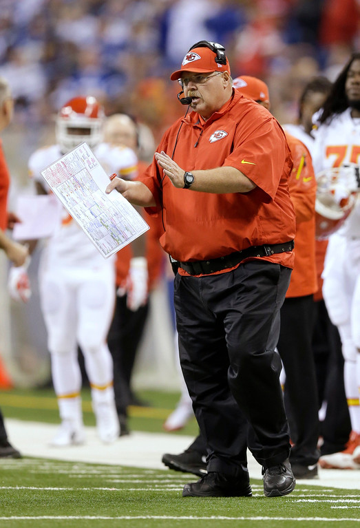 . Kansas City Chiefs head coach Andy Reid directs play from the sideline against the Indianapolis Colts during the first half of an NFL wild-card playoff football game Saturday, Jan. 4, 2014, in Indianapolis. (AP Photo/Michael Conroy)