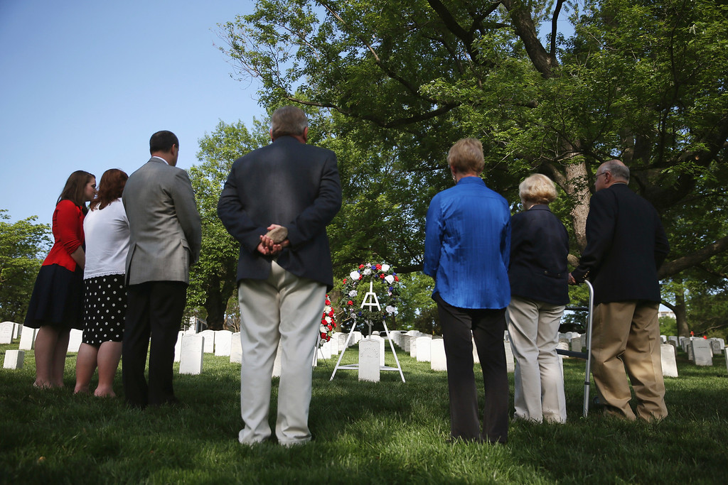 . ARLINGTON, VA - MAY 13: Decendants participate in a wreath layinmg ceremony at the grave of Army Pvt. William Christman, as part of Arlington at 150 Celebration on May 13, 2014 in Washington, DC. P  (Photo by Mark Wilson/Getty Images)