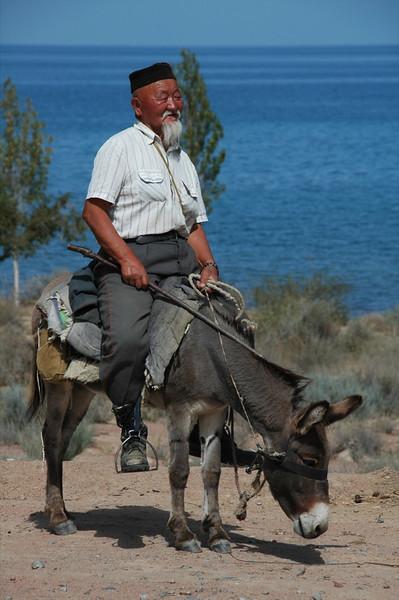 Old Kyrgyz Man on a Donkey - Lake Issyk-Kul, Kyrgyzstan