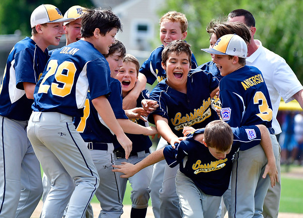 8/10/2019 Mike Orazzi | Staff Rhode Islands Barrington Little League celebrates a win Saturday over New Hampshires Goffstown Junior Baseball Little League at Breen Field in Bristol, Conn., during the New England Regional and advancing to the Little League World Series in Williamsport PA.