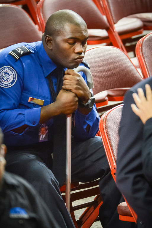 . Wounded TSA officer Tony Grigsby sits after the memorial for slain TSA officer Gerardo Hernandez at the Los Angeles Sports Arena Tuesday, November 12, 2013.  A public memorial was held for Officer Gerardo who was killed at LAX when a gunman entered terminal 3 and opened fire with a semi-automatic rifle, Grigsby was wounded in the attack.  ( Photo by David Crane/Los Angeles Daily News )