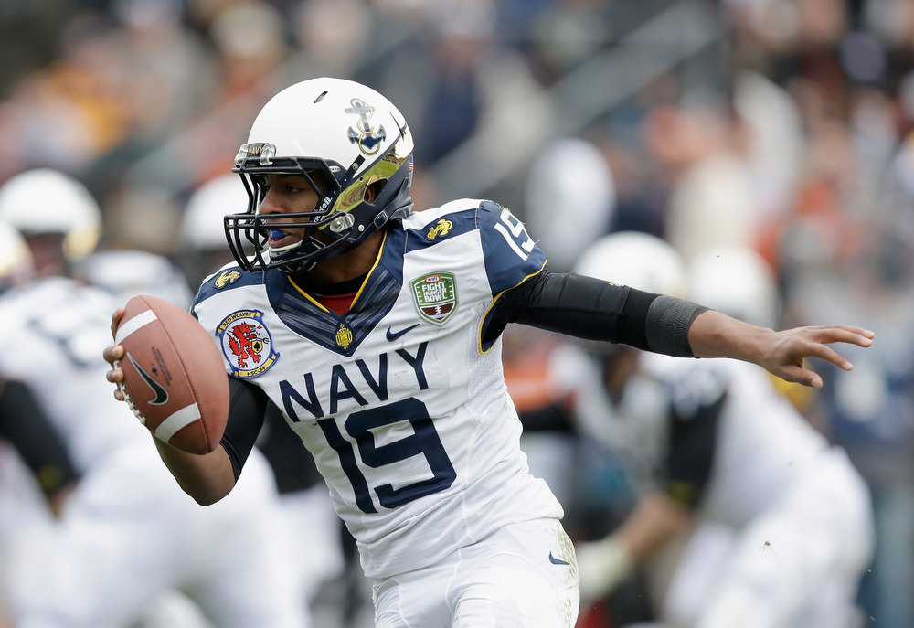 Description of . Keenan Reynolds #19 of the Navy Midshipmen scrammbles with the ball against the Arizona State Sun Devils during the Kraft Fight Hunger Bowl at AT&T Park on December 29, 2012 in San Francisco, California.  (Photo by Ezra Shaw/Getty Images)