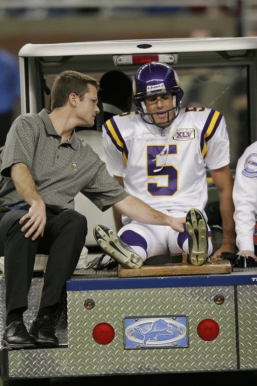 . Minnesota\'s Chris Kluwe is carted off the field after getting hit while punting the ball against the Detroit Lions at Ford Field on December 4, 2005 in Detroit, Michigan. The Vikings won the game 21-16.  (Photo by Tom Pidgeon/Getty Images)