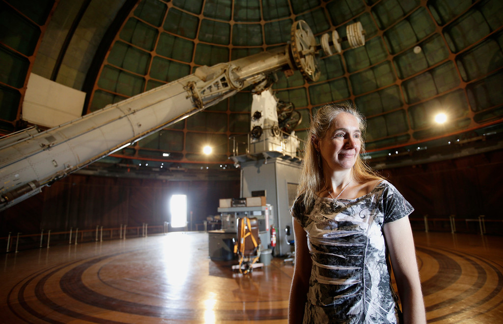". Astronomer Elinor Gates stands next to the 36"" Refractor telescope at Lick Observatory east of San Jose, Calif. on Wednesday, May 8, 2013. The observatory will be celebrating its 125th anniversary.  (Gary Reyes/ Bay Area News Group)"