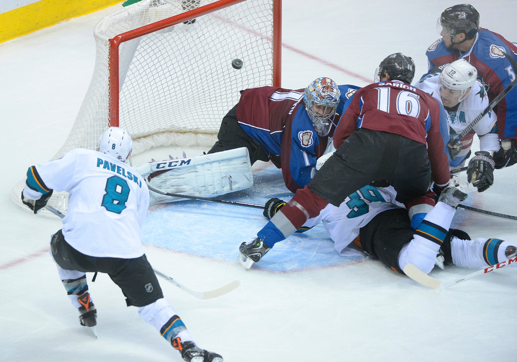 . DENVER, CO. - JANUARY 04:  San Jose center Joe Pavelski (8) tapped the puck into the net past Avs\' goalie Semyon Varlamov in the second period. The Colorado Avalanche hosted the San Jose Sharks at the Pepsi Center Saturday afternoon, January 4, 2014. Photo By Karl Gehring/The Denver Post