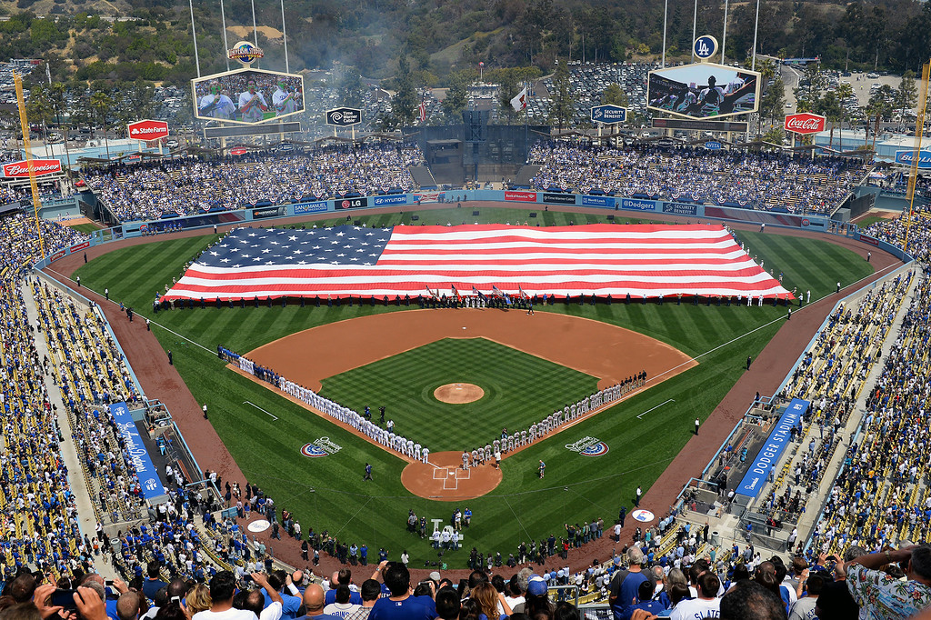 . The American flag is unfurled at the Dodgers home opener, Friday, April 4, 2014, at Dodger Stadium. (Photo by Michael Owen Baker/L.A. Daily News)