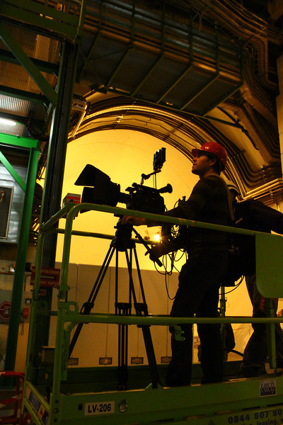 "Me filming crane shots inside the LHCb experiment, located in Ferney-Voltaire, France, which is creating and studying anti-matter to help us to understand why we live in a Universe that appears to be composed almost entirely of matter, but no antimatter. It's a fascinating coincidence that Voltaire lived here in the 18th century and wrote about ""possible worlds"" without knowing the world's largest machine would be built directly under the soil he walked on to study related ideas.  Photo by David Marks."