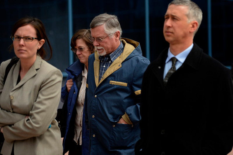 . Arlene and Robert Holmes, (center) parents of Aurora theater shooting suspect James Holmes, leaving the Arapahoe County Justice Center April 01, 2013 Centennial, Colorado. (Photo By Joe Amon/The Denver Post)