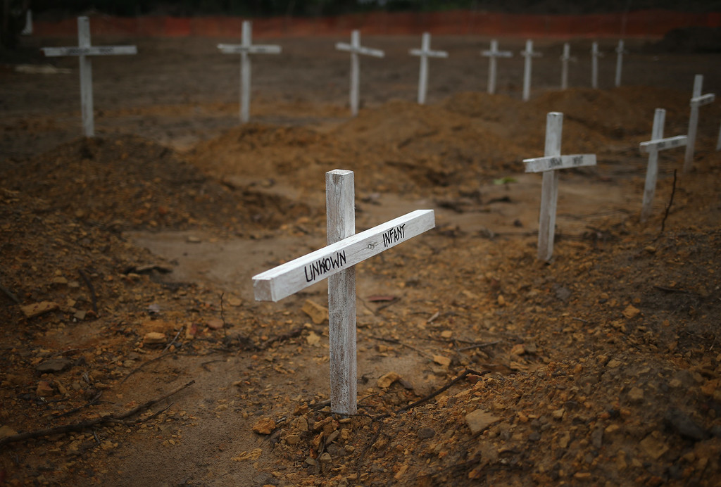 ". Crosses mark the graves of unknown infants buried in the U.S.-built cemetery for ""safe burials\"" on January 27, 2015 in Disco Hill, Liberia.   (Photo by John Moore/Getty Images)"