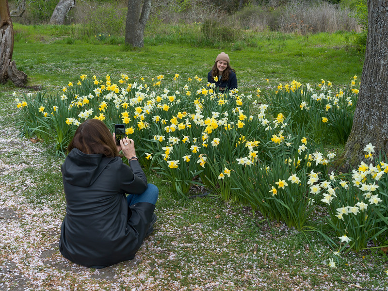 Woman photographing her friend in park, Beacon Hill Park, Fairfield, Victoria, British Columbia, Canada
