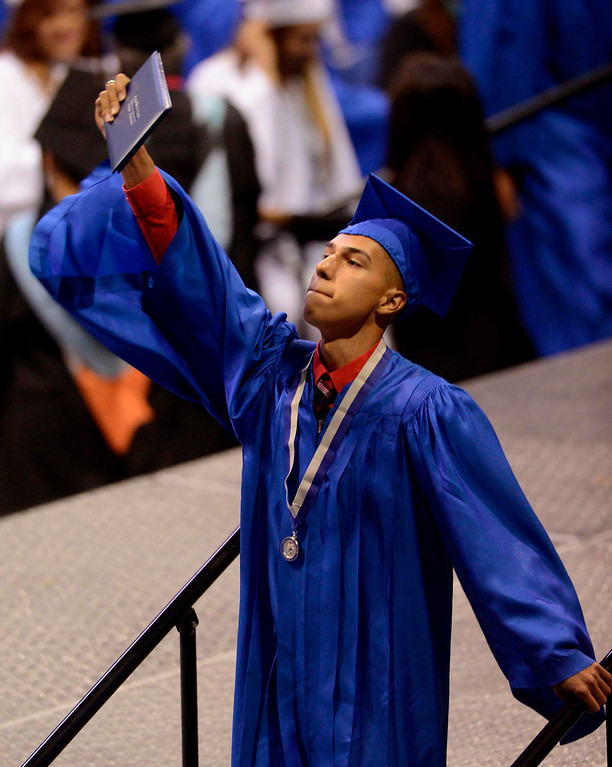 . Arturo Simental reacts as he receives his diploma during Rialto High School Commencement Exercises held at Citizens Bank Arena in Ontario June 2, 2013.  The school graduated 570 seniors.  GABRIEL LUIS ACOSTA/STAFF PHOTOGRAPHER.