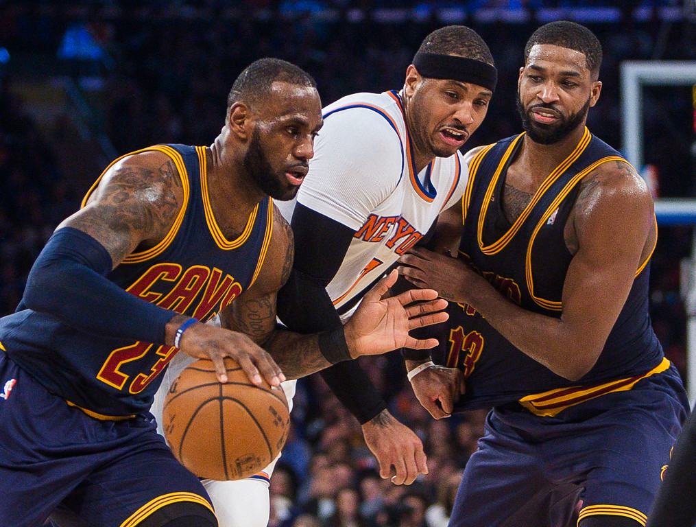 . Cleveland Cavaliers\' LeBron James (23) drives to the basket against New York Knicks\' Carmelo Anthony, center, as Cleveland Cavaliers\' Tristan Thompson slows Anthony during the first half of an NBA basketball game, Saturday, Feb. 4, 2017, in New York. (AP Photo/Andres Kudacki)